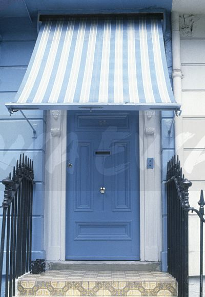 Striped Awning Above Blue Front Door