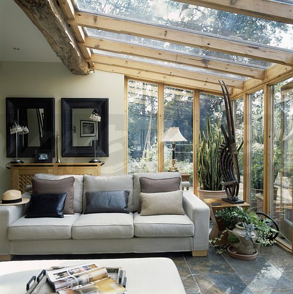 living room conservatories image pale grey sofa below mirrors in modern conservatory 10848