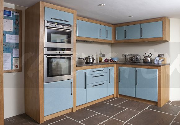 Neff Multi Function And Single Oven In Tower Unit In Modern Kitchen With  Oak And Pale Blue Units And Indian Stone Floor