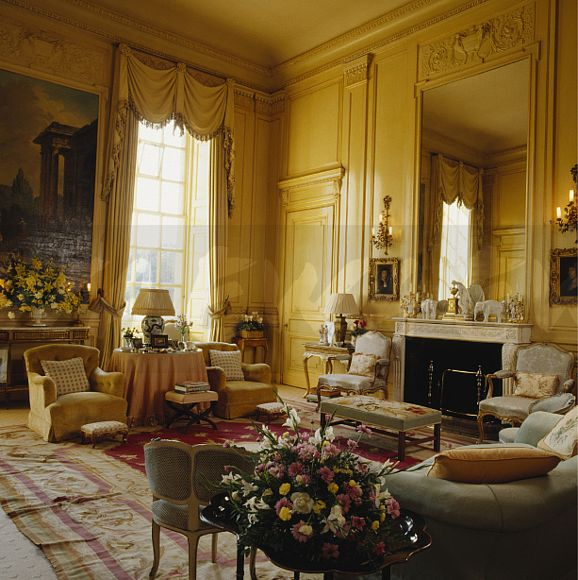 Traditional Yellow Country Drawing Room With Large Mirror Above Fireplace