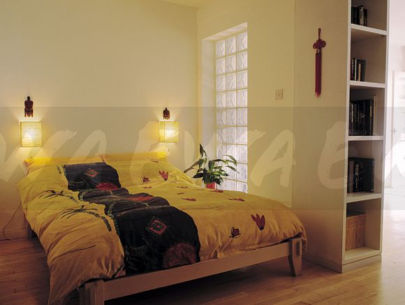 Image Wall Lights Above Colourful Duvet On Bed Beside Glass Brick Classy Basement Bedroom Window Style Property