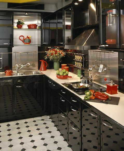 Black Ed Units With White Worktops In Modern Kitchen Chequerboard Vinyl Floor And Red Accessories