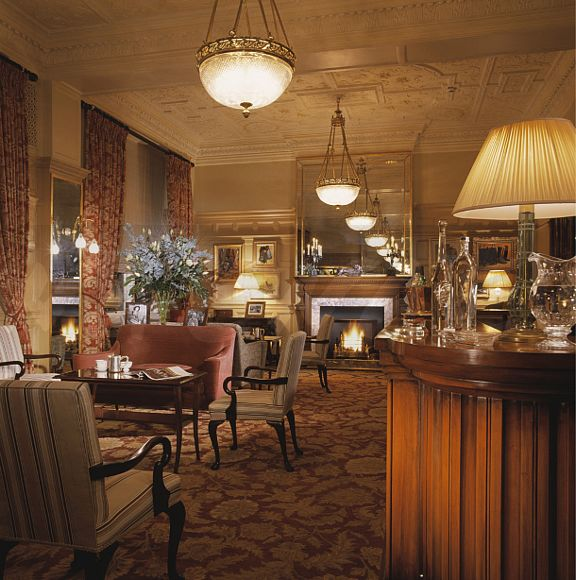 Traditional Bar With Comfortable Seating In Large Old Style London Hotel