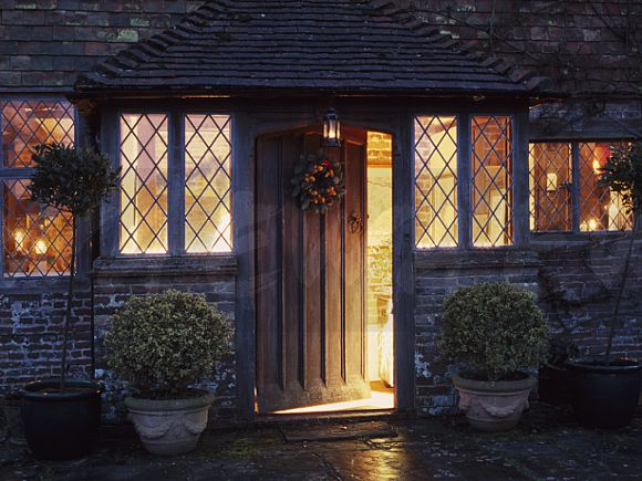 Image lighted windows in country house with clipped for High end front doors