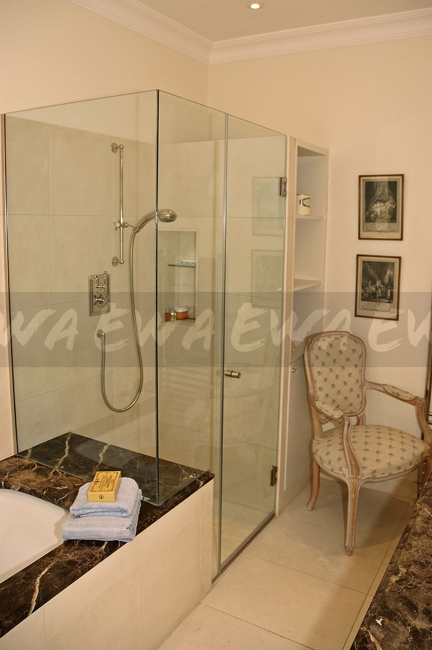Image: Glass shower cubicle at the end of the bath in traditional ...