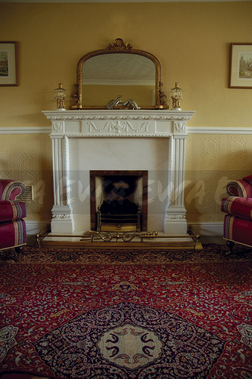 Antique Gilt Mirror Above White Fireplace In Old Fashioned Living Room With  Red Patterned Carpet