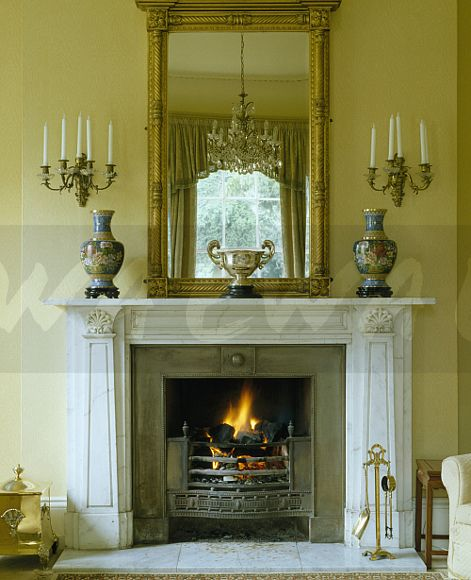 Image: Georgian overmantel mirror above marble fireplace ...