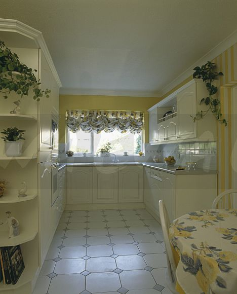 image pastel yellow kitchen diningroom with white tiled