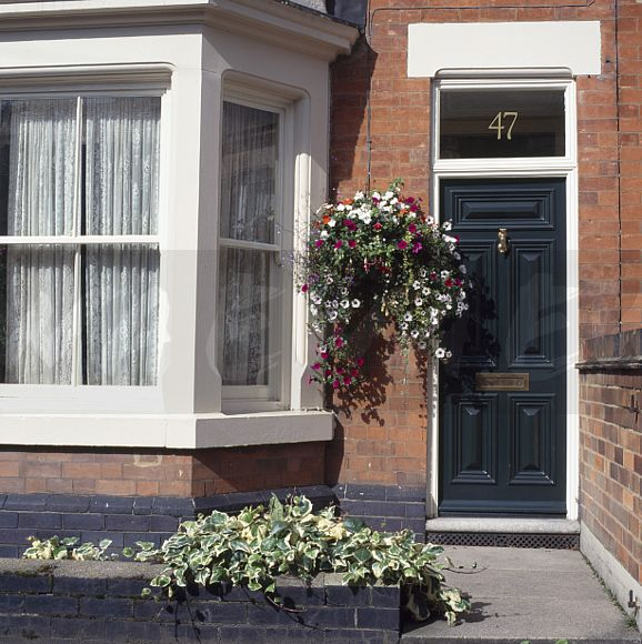 Front Door Baskets: Image: Hanging Basket Beside Black Front Door On Small