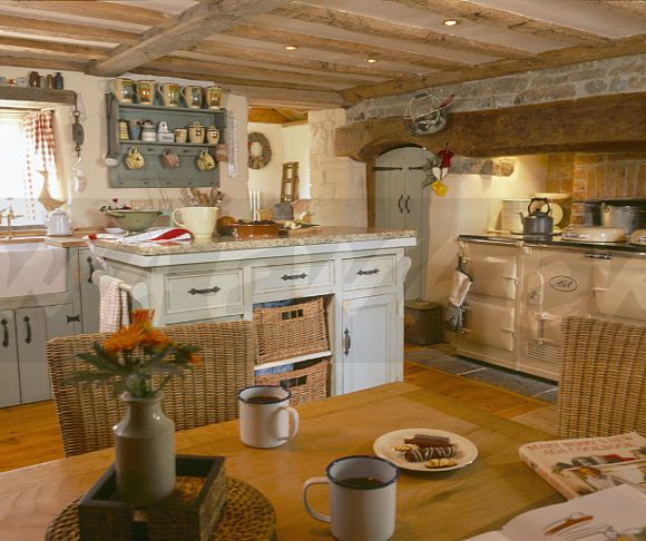 Image: Cream Aga And Pine Table In Cottage Kitchen With
