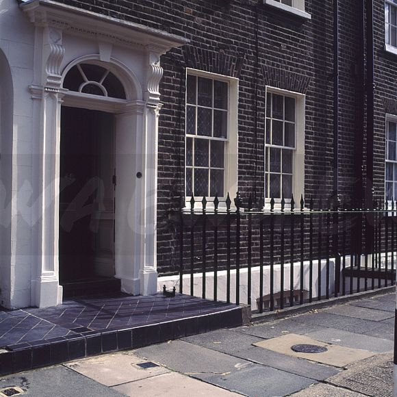 Black Cast Iron Railings In Front Of Traditional Georgian Townhouse With Door