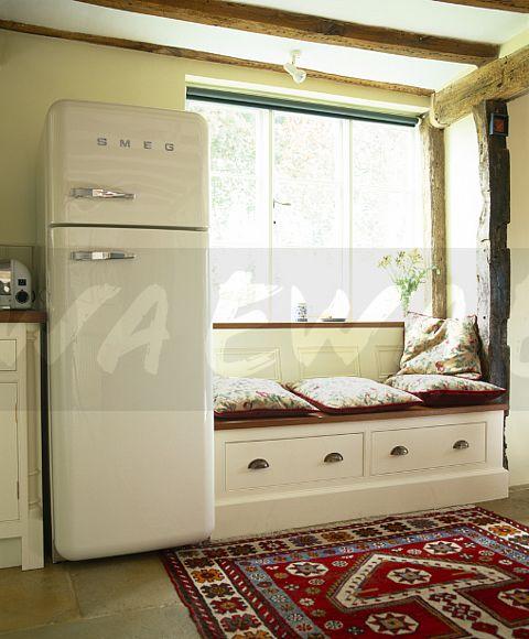 Country Kitchen Fridge: Image: Smeg Fridge-freezer Beside Window Seat With Storage