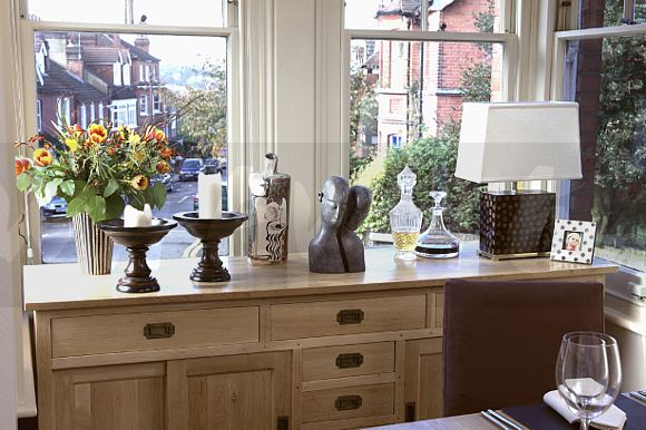 Image white lamp and candles on fitted sideboard in front What can i put on my sideboard