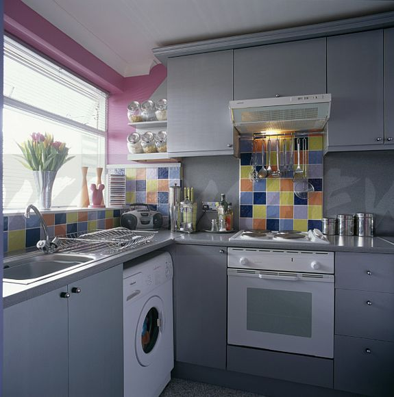 Image Multi Coloured Tiles Above Oven And Worktop In Grey