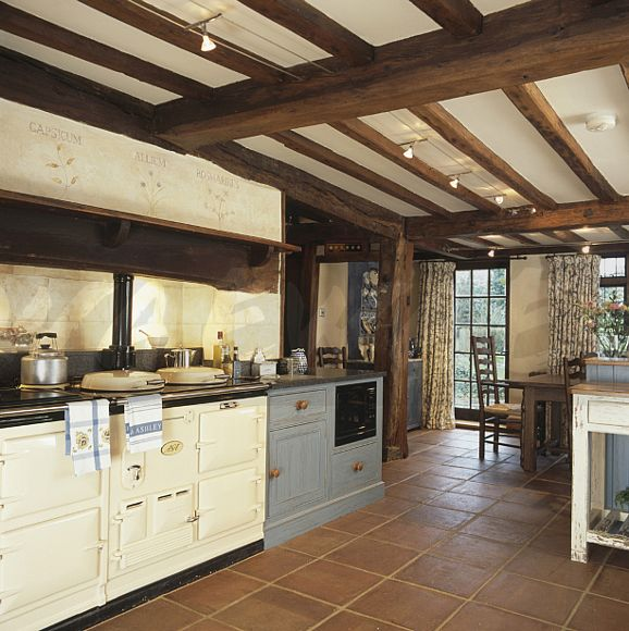 Image Cream Aga In Country Kitchen With Terracotta Tiled Floor And