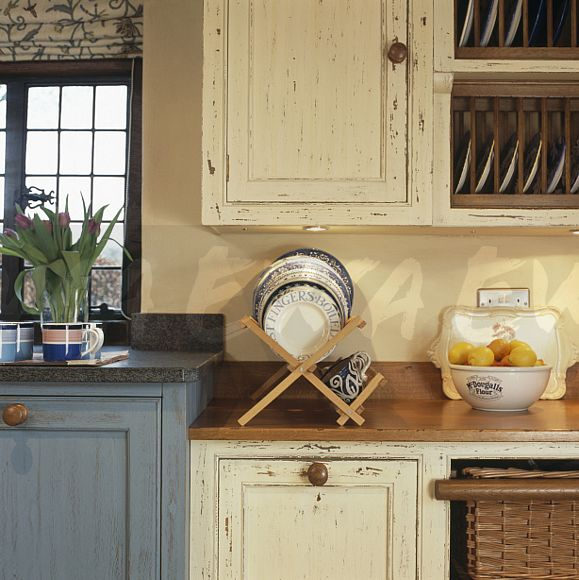 Image distressed paint effect cream cupboards and wood for Wood effect kitchen cupboards