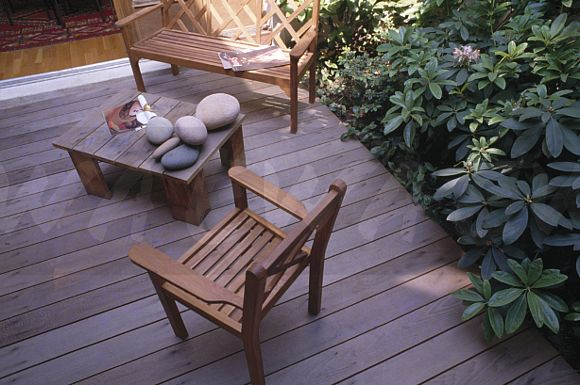 Awe Inspiring Image Wooden Bench And Chair On Decking With Large Pebbles Ibusinesslaw Wood Chair Design Ideas Ibusinesslaworg