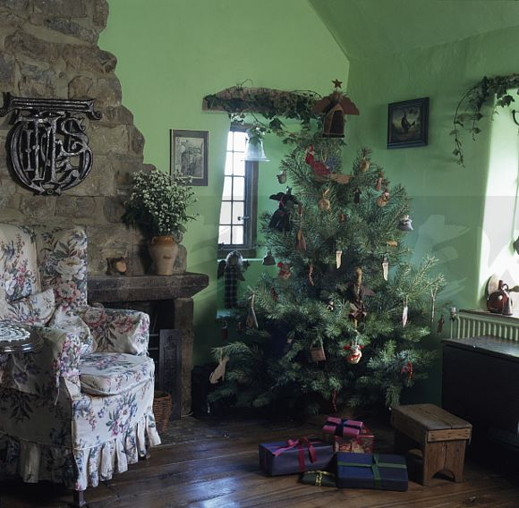Image Christmas Tree In Corner Of Green Cottage Living Room With