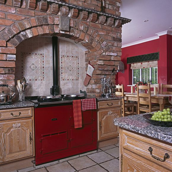 Image Exposed Brick Wall Above Red Aga Oven In Large Country