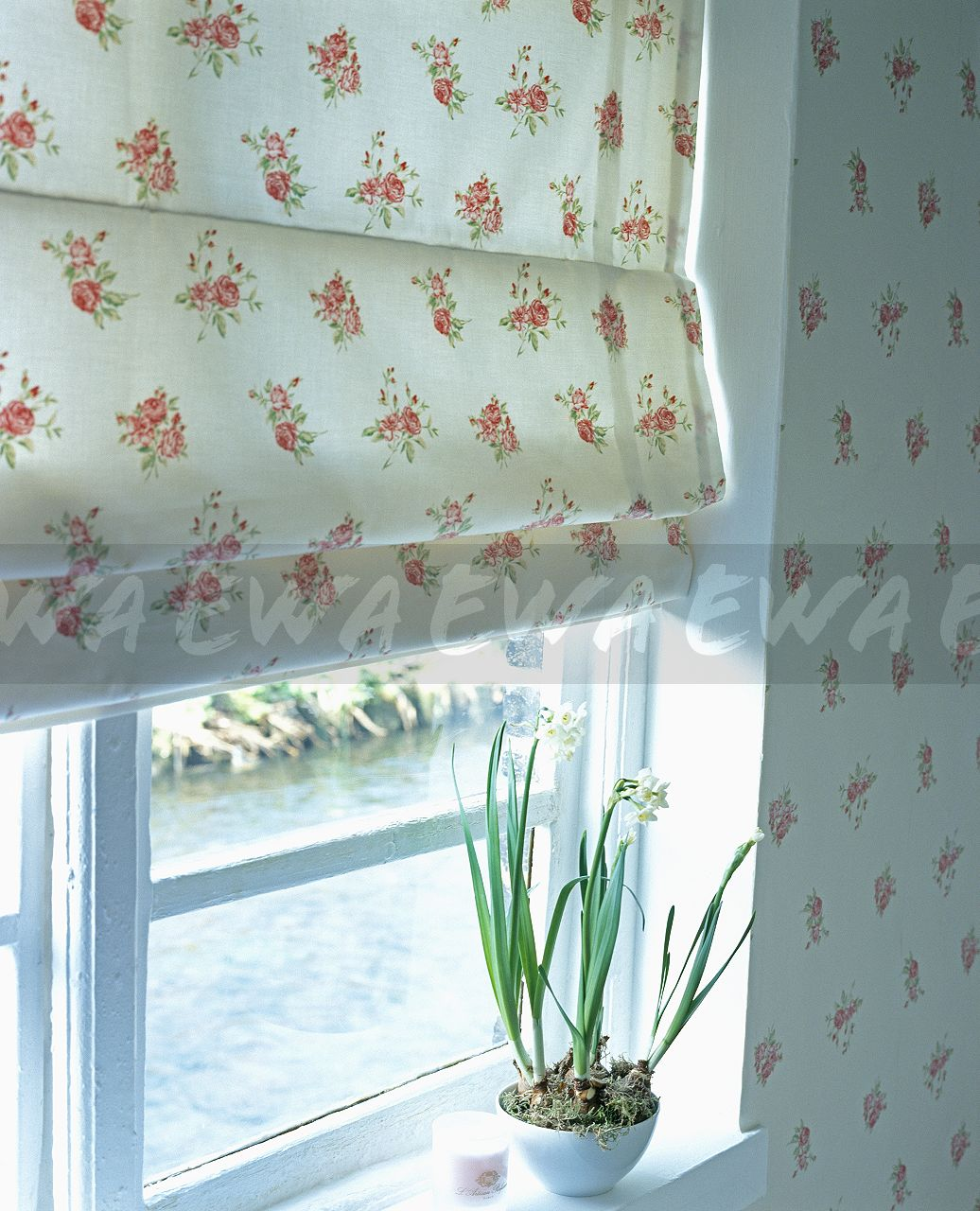 Image Closeup of rosepatterned blind in bedroom with matching