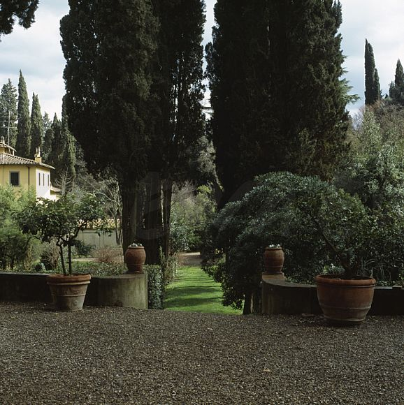 Gravelled Terrace With Shrubs In Large Terracotta Pots Italian Country Garden Avenue Of Tall Cypress Trees