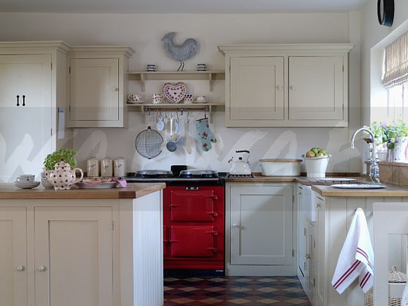 Image Red Aga Oven In Country Kitchen With Cream Fitted Units Ewa