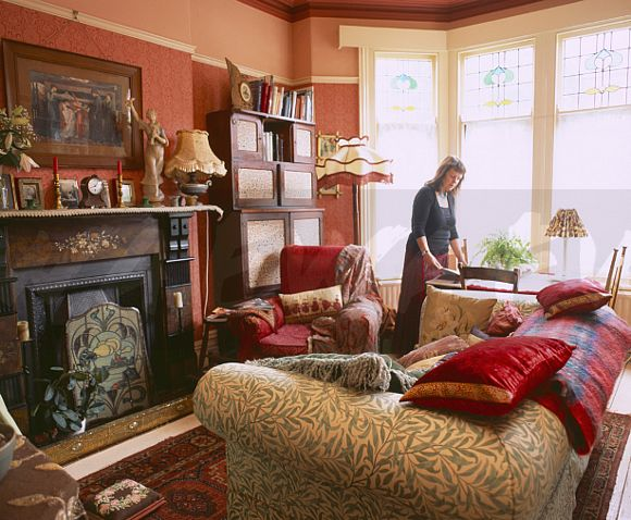 Woman In Edwardian Style Living Room FOR EDITORIAL USE ONLY