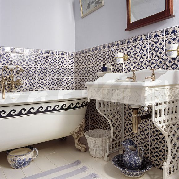 Victorian Basin And Rolltop Bath In Pale Blue Bathroom With White Patterned Wall Tiles To Dado Height