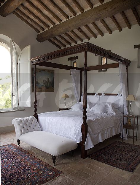 White Chaise Longue Below Simple Four Poster Bed With Crisp Bedlinen In Italian Country Bedroom