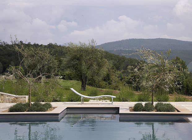 White Lounger Beside Swimming Pool In Garden Of Italian Country Villa With View Wooded Hills
