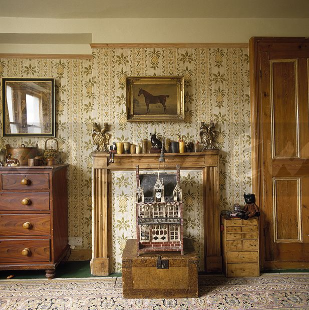 Image Small Doll S House On A Wooden Box In Front Of The Fireplace In An Edwardian Style Bedroom With Patterned Wallpaper Ewa Stock Photo Library