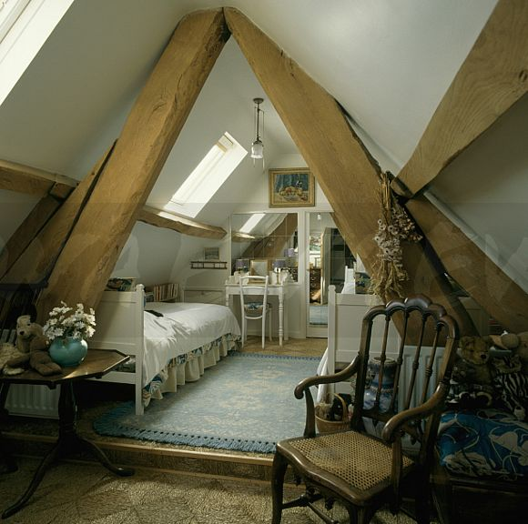 bedroom marvelous ideas with wooden roofs | Image: Large wooden support beams in attic bedroom with ...