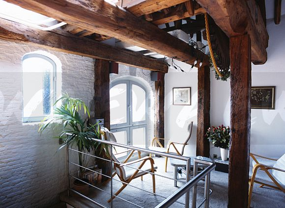 Image large rustic wooden beams in apartment hall in for Low cost apartments amsterdam