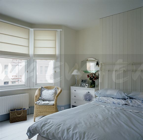Image: Cream Blinds On Bay Window In Townhouse Bedroom
