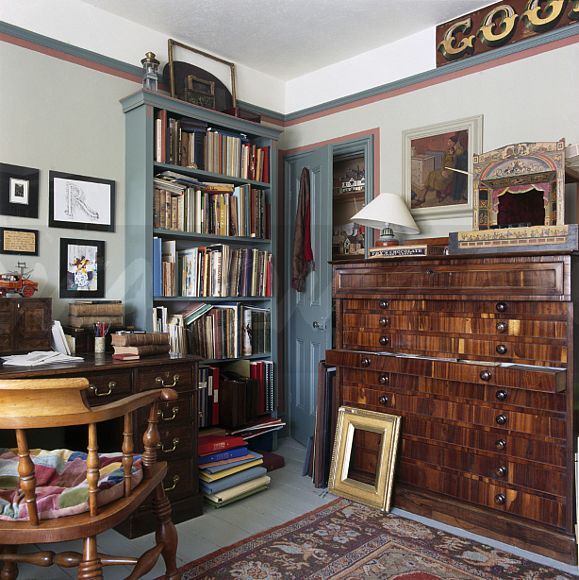 Blue painted bookcase in old fashioned study ewa stock photo library