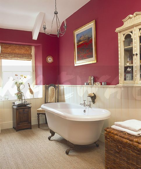 Image rolltop bath in dark pink bathroom with cream for Bathroom ideas using tongue and groove