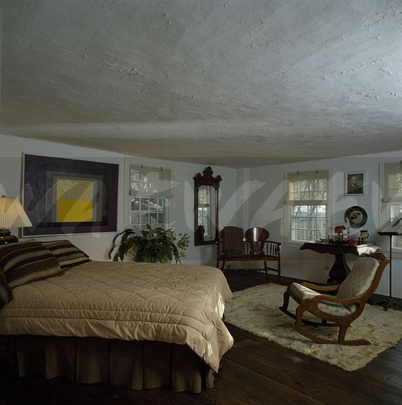 Image: Bed With Cream Quilt In Nineties Bedroom With
