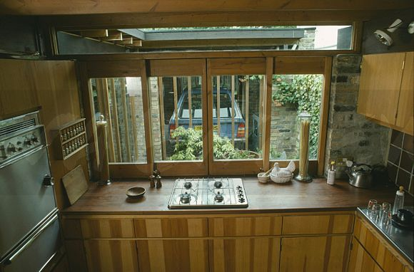 Kitchen Hob Side View ~ Image seventies kitchen with gas hob in wood worktop
