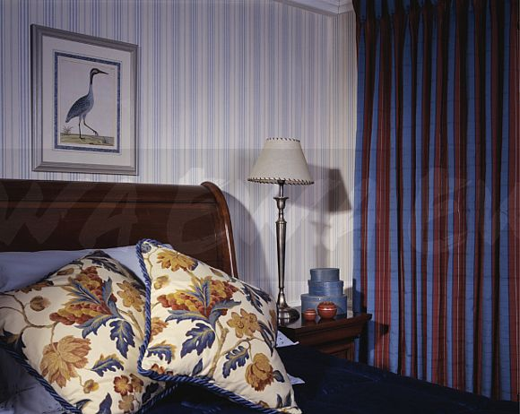 Image Floral Cushions On Bed In Hotel Bedroom With Red Blue Striped Curtains And Blue White