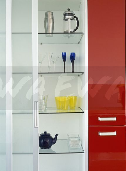 image close up of glass shelves in cupboard with sliding glass door