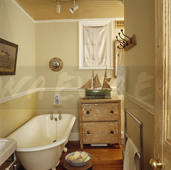 Image Model Sailing Boat On Old Pine Chest Of Drawers Beside Roll Top Bath In Small Cream