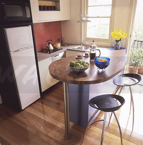 Image Black Stools At Oval Breakfast Bar With Cafetiere