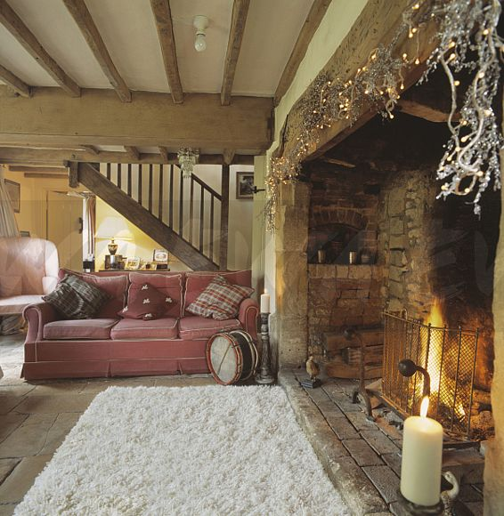Image Beamed Country Living Room With Sheepskin Rug In