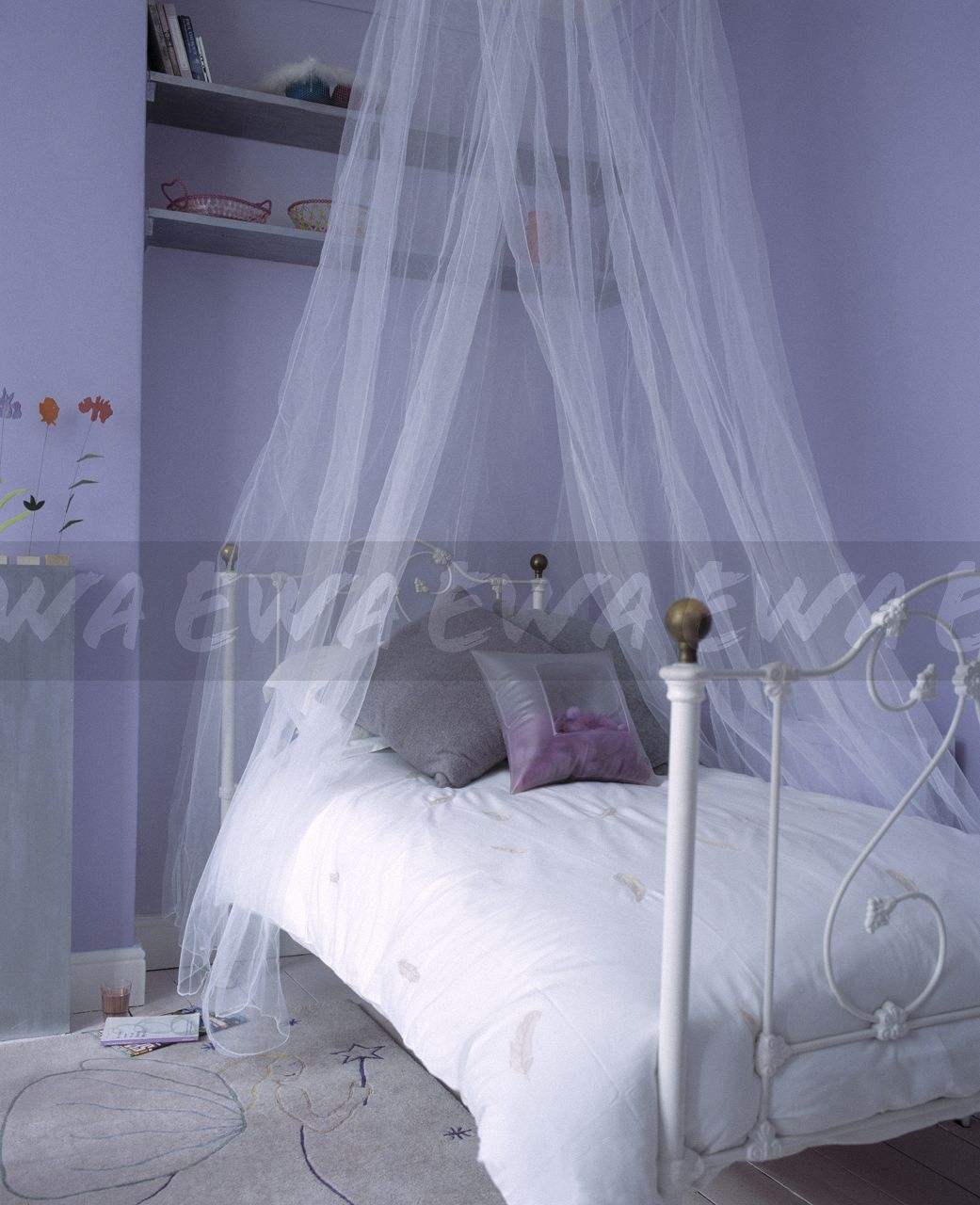 image sheer white voile curtains above white wrought iron bed with