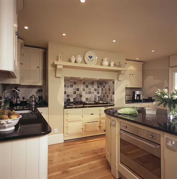 Image cream aga oven in country kitchen with built in for Cream country kitchen designs