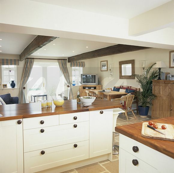 Image: Cream Cottage Kitchen With White Beamed Ceiling And