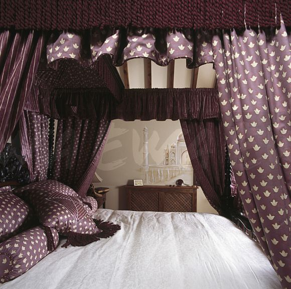 Image Patterned Purple Drapes With Burgandy Fringing On Four Poster Bed With Matching Purple