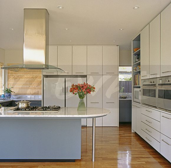 White Kitchen Units With Oak Worktop: Image: Stainless Steel Extractor Above Hob In White